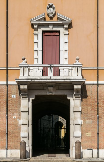Portal of the palace with the coat-of-arms of the Pasolini family above the tympanum of the balcony window