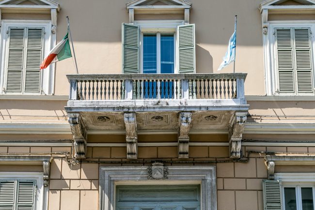 The balcony above the portal of the palace with the coat of arms of Rasponi