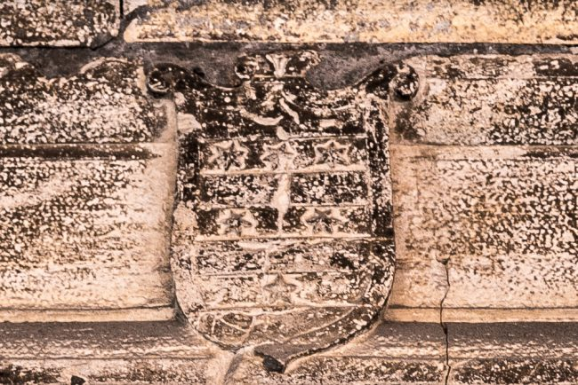 The coat-of-arms of Ghigi family above the doorway