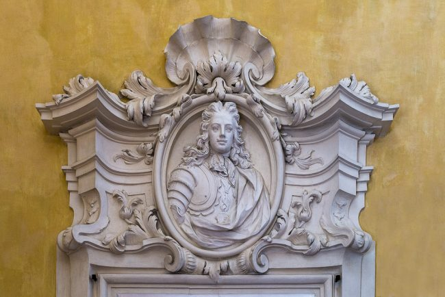 Stucco portrait above door in the entrance hall