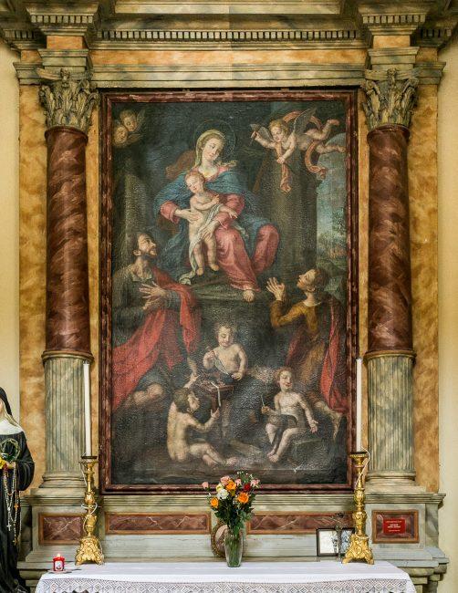 a Vergine con il Bambino ed i Santi Crispino e Crispiniano (Domenico Cignani di Ravenna – sec. XVIII) – Navata destra