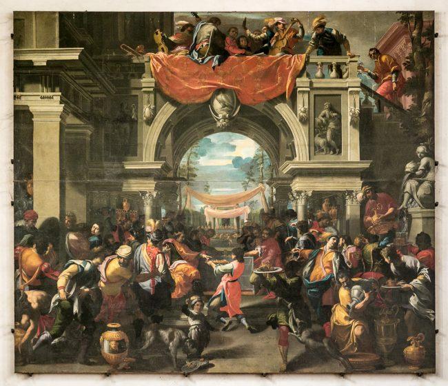 The banquet of Ahasuerus, di Carlo Bononi, oil on canvas, 600x700 cm, 1620 ca. (wall above the entrance to the church door)